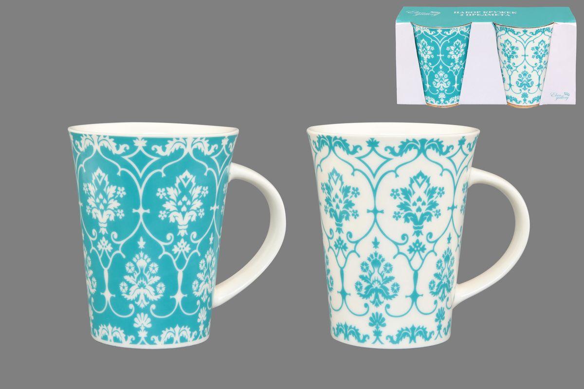 Набор кружек Elan Gallery Дамаск, цвет: белый, бирюзовый, 320 мл, 2 шт115510Набор Elan Gallery Дамаск состоит из двух кружек, выполненных из керамики.Этот необычный набор станет великолепным подарком для каждого и, несомненно, вызовет восхищение. Объем кружек: 320 мл. Диаметр кружек (по верхнему краю): 8,5 см. Высота кружек: 11 см. Не рекомендуется применять абразивные моющие средства. Не использовать в микроволновой печи.