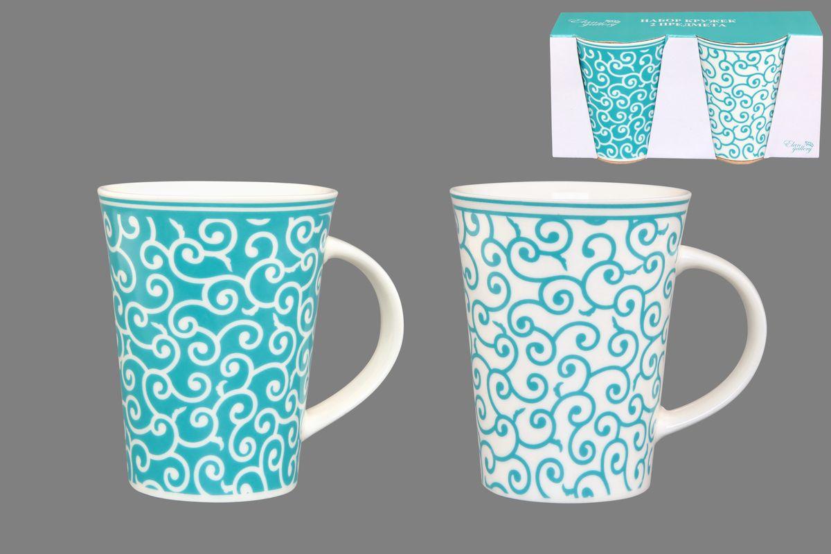 Набор кружек Elan Gallery Арабески, цвет: белый, бирюзовый, 320 мл, 2 шт115510Набор Elan Gallery Арабески состоит из двух кружек, выполненных из керамики.Этот необычный набор станет великолепным подарком для каждого и, несомненно, вызовет восхищение. Объем кружек: 320 мл. Диаметр кружек (по верхнему краю): 8,5 см. Высота кружек: 11 см.Не рекомендуется применять абразивные моющие средства. Не использовать в микроволновой печи.