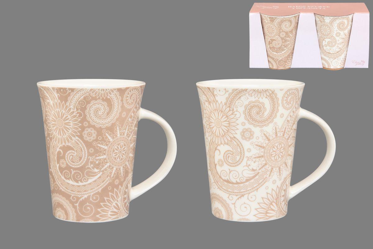 Набор кружек Elan Gallery Цветы и завитушки, цвет: белый, бежевый, 320 мл, 2 шт115510Набор Elan Gallery Цветы и завитушки состоит из двух кружек, выполненных из керамики.Этот необычный набор станет великолепным подарком для каждого и, несомненно, вызовет восхищение. Объем кружек: 320 мл. Диаметр кружек (по верхнему краю): 8,5 см. Высота кружек: 11 см.Не рекомендуется применять абразивные моющие средства. Не использовать в микроволновой печи.