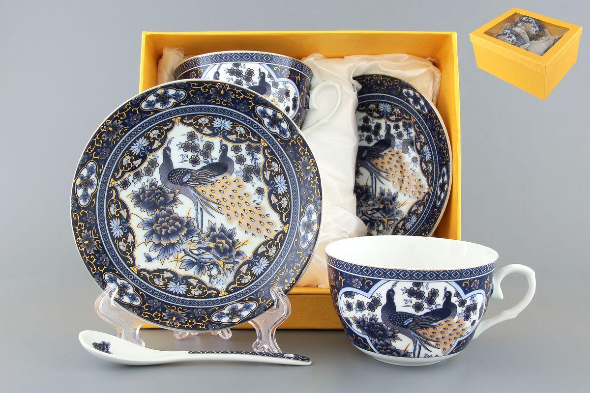 Набор чайный Elan Gallery Павлин синий, с ложками, 6 предметов115510Чайный набор Elan Gallery Павлин синий состоит из 2 чашек, 2 блюдец и 2 ложек. Изделия, выполненные из высококачественной керамики, имеют элегантный дизайн и классическую круглую форму.Такой набор прекрасно подойдет как для повседневного использования, так и для праздников. Чайный набор Elan Gallery Павлин синий - это не только яркий и полезный подарок для родных и близких, а также великолепное дизайнерское решение для вашей кухни или столовой. Не использовать в микроволновой печи.Объем чашки: 250 мл. Диаметр чашки (по верхнему краю): 9,5 см. Высота чашки: 6 см.Диаметр блюдца (по верхнему краю): 14 см.Высота блюдца: 2 см.Длина ложки: 13 см.