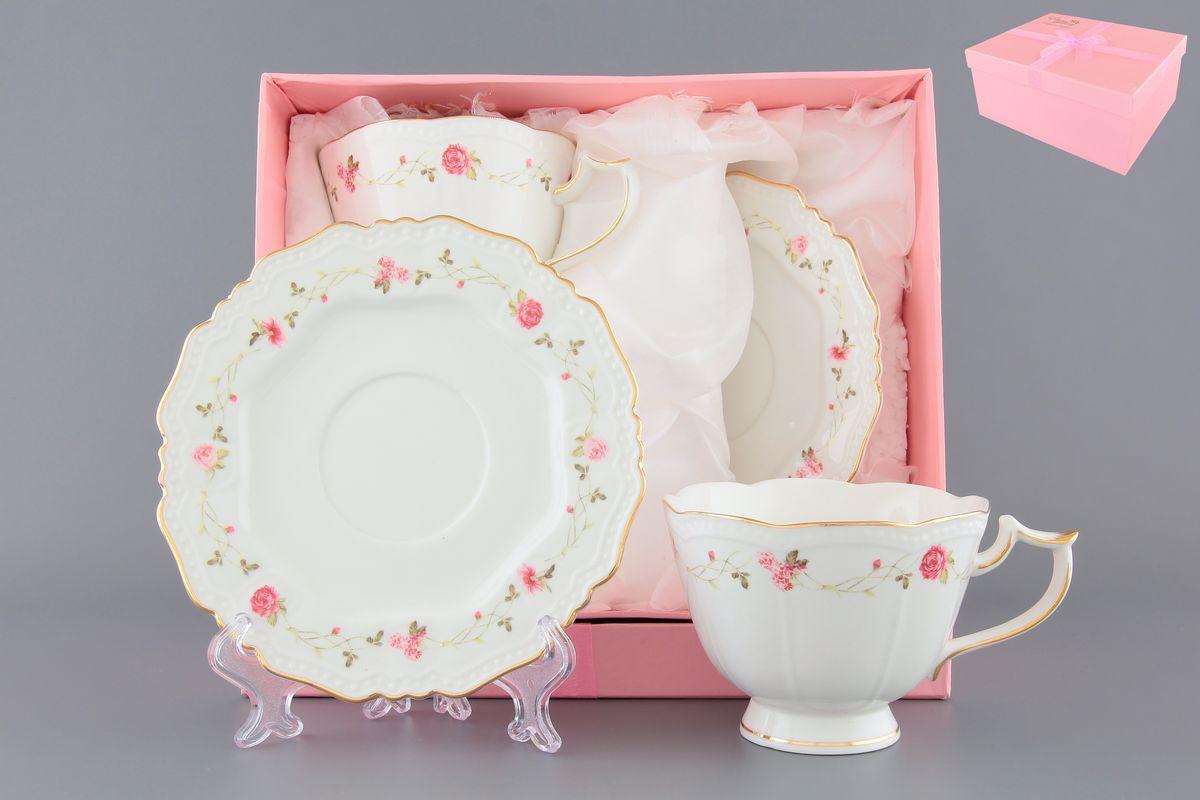 Чайная пара Elan Gallery Нежные розы, 4 предмета115510Чайный набор с нежнейшим цветочным узором на 2 персоны украсит Ваше чаепитие. В комплекте 2 чашки на ножке объемом 275 мл, 2 блюдца. Изделие имеет подарочную упаковку, поэтому станет желанным подарком для Ваших близких!
