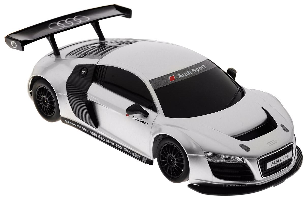 """Радиоуправляемая модель Rastar """"Audi R8 LMS"""" станет отличным подарком любому мальчику! Все дети хотят иметь в наборе своих игрушек ослепительные, невероятные и крутые автомобили на радиоуправлении. Тем более, если это автомобиль известной марки с проработкой всех деталей, удивляющий приятным качеством и видом. Одной из таких моделей является автомобиль на радиоуправлении Rastar """"Audi R8 LMS"""". Это точная копия настоящего авто в масштабе 1:24. Возможные движения: вперед, назад, вправо, влево, остановка. Имеются световые эффекты. Пульт управления работает на частоте 40 MHz. Для работы игрушки необходимы 3 батарейки типа АА (не входят в комплект). Для работы пульта управления необходимы 2 батарейки типа АА (не входят в комплект)."""