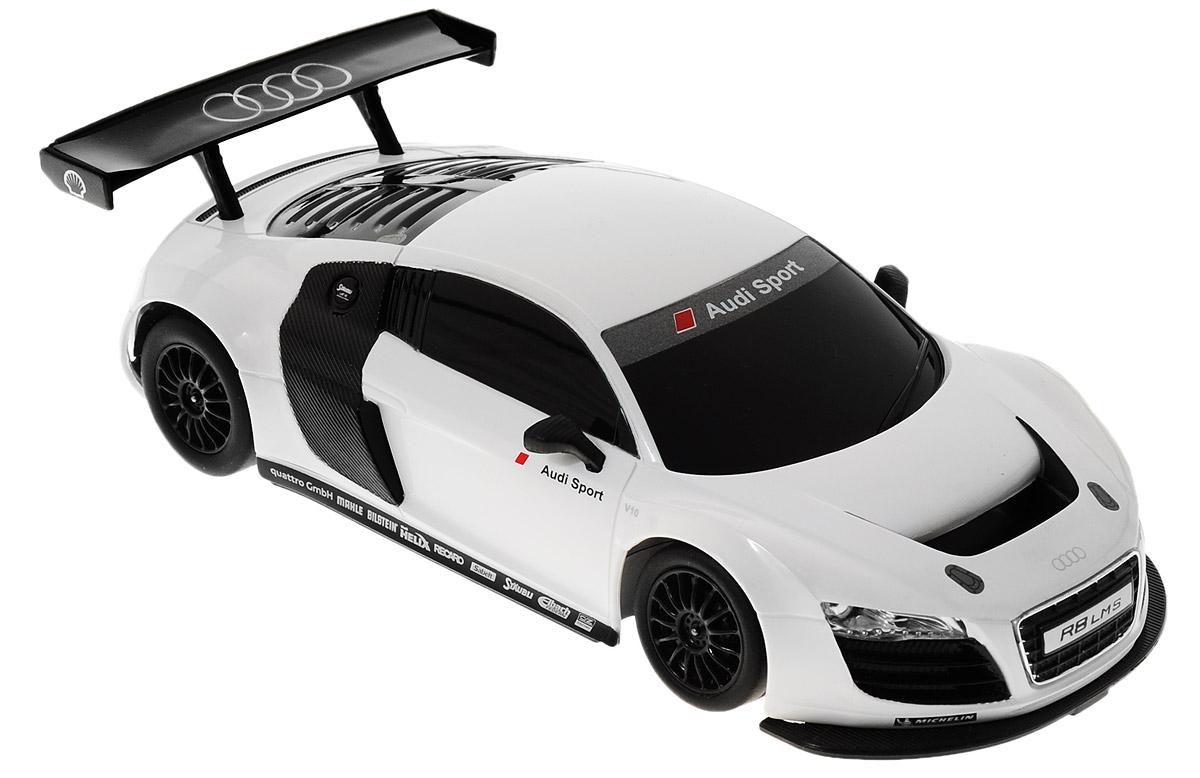 """Радиоуправляемая модель Rastar """"Audi R8 LMS"""" станет отличным подарком любому мальчику! Все дети хотят иметь в наборе своих игрушек ослепительные, невероятные и крутые автомобили на радиоуправлении. Тем более, если это автомобиль известной марки с проработкой всех деталей, удивляющий приятным качеством и видом. Одной из таких моделей является автомобиль на радиоуправлении Rastar """"Audi R8 LMS"""". Это точная копия настоящего авто в масштабе 1:24. Возможные движения: вперед, назад, вправо, влево, остановка. Имеются световые эффекты. Пульт управления работает на частоте 27 MHz. Для работы игрушки необходимы 3 батарейки типа АА (не входят в комплект). Для работы пульта управления необходимы 2 батарейки типа АА (не входят в комплект)."""