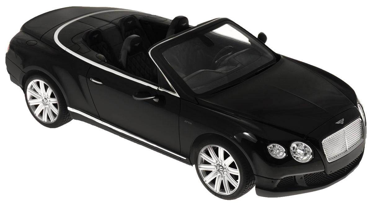 """Радиоуправляемая модель Rastar """"Bentley Continental GT Speed Convertible"""" станет отличным подарком любому мальчику! Все дети хотят иметь в наборе своих игрушек ослепительные, невероятные и крутые автомобили на радиоуправлении. Тем более, если это автомобиль известной марки с проработкой всех деталей, удивляющий приятным качеством и видом. Одной из таких моделей является автомобиль на радиоуправлении Rastar """"Bentley Continetal GT Speed Convertible"""". Это точная копия настоящего авто в масштабе 1:12. Авто обладает неповторимым провокационным стилем и спортивным характером. Потрясающая маневренность, динамика и покладистость - отличительные качества этой модели. Возможные движения: вперед, назад, вправо, влево, остановка. Имеются световые эффекты. Пульт управления работает на частоте 27 MHz. Для работы игрушки необходимы 5 батареек типа АА (не входят в комплект). Для работы пульта управления необходима 1 батарейка 9V (6F22) (не входит в комплект)."""