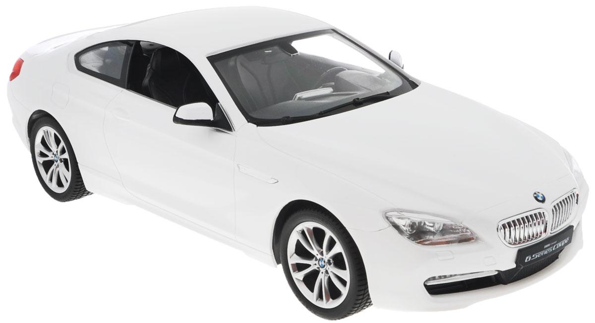 """Радиоуправляемая модель Rastar """"BMW 6 Series"""" станет отличным подарком любому мальчику! Все дети хотят иметь в наборе своих игрушек ослепительные, невероятные и крутые автомобили на радиоуправлении. Тем более, если это автомобиль известной марки с проработкой всех деталей, удивляющий приятным качеством и видом. Одной из таких моделей является автомобиль на радиоуправлении Rastar """"BMW 6 Series"""". Это точная копия настоящего авто в масштабе 1:14. Авто обладает неповторимым провокационным стилем и спортивным характером. Потрясающая маневренность, динамика и покладистость - отличительные качества этой модели. Возможные движения: вперед, назад, вправо, влево, остановка. Имеются световые эффекты. Пульт управления работает на частоте 40 MHz. Для работы игрушки необходимы 5 батареек типа АА (не входят в комплект). Для работы пульта управления необходима 1 батарейка 9V (6F22) (не входит в комплект)."""
