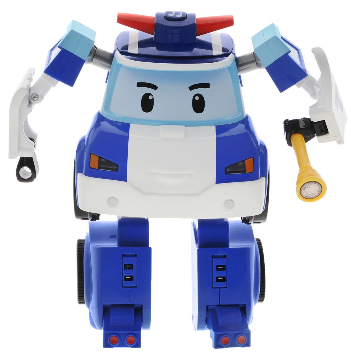 """Робот-трансормер на радиоуправлении """"Поли"""" непременно понравится вашему ребенку. Он выполнен в виде полицейской машинки-робота Поли - персонажа мультфильма """"Robocar Poli"""". У робота подвижные руки и ноги. В комплект с ним входят: фонарик, полицейская дубинка, бензопила и дрель. Поли может трансформироваться в машинку. В форме машинки он может управляться с пульта. Поли-машинка при помощи пульта управления может двигаться вперед, назад, поворачивать влево и вправо, включать передние фары, звук сирены и мелодии. Робот-машинка Поли непременно наведет порядок в городке Брумстаун. Порадуйте своего малыша таким замечательным подарком! Необходимо докупить 7 батареек напряжением 1,5V типа ААА (не входят в комплект)."""
