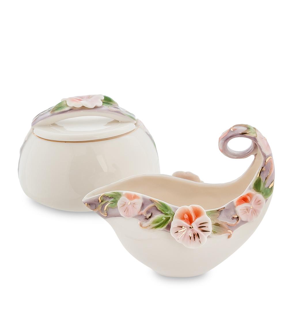 Набор Pavone Виола, 2 предмета115510Набор Pavone Виола состоит из сахарницы и молочника,изготовленных из фарфора. Предметы набора оформленыизящными объемными цветами.Набор Pavone Виола украсит ваш кухонный стол, а такжестанет замечательным подарком друзьям и близким.Изделие упаковано в подарочную коробку с атласной подложкой. Объем сахарницы: 200 мл.Объем молочника: 100 мл.