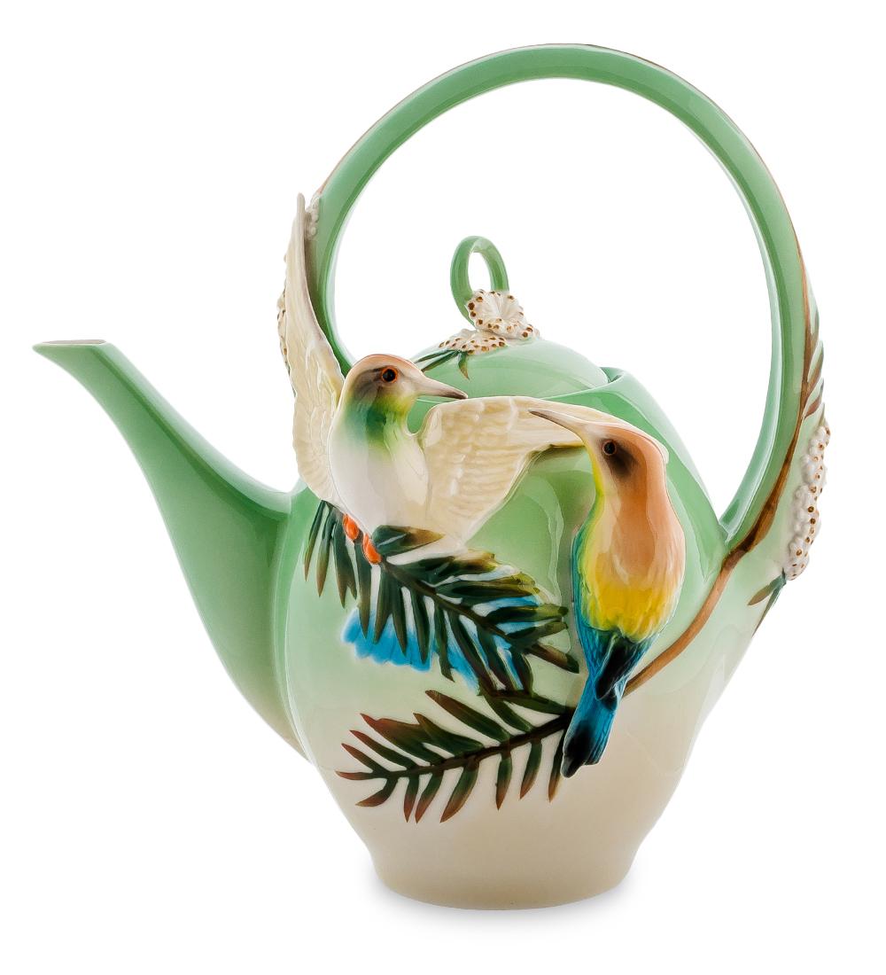 Чайник заварочный Pavone Радужная щурка, 1,5 л9535BHЧайник заварочный Pavone Радужная щурка изготовлен из высококачественной фарфора. Изделие украшено объемными изображениями птиц. Такой чайник прекрасно дополнит сервировку стола к чаепитию и станет его неизменным атрибутом.Диаметр (по верхнему краю): 7,5 см. Высота чайника (с учетом ручки): 25 см.