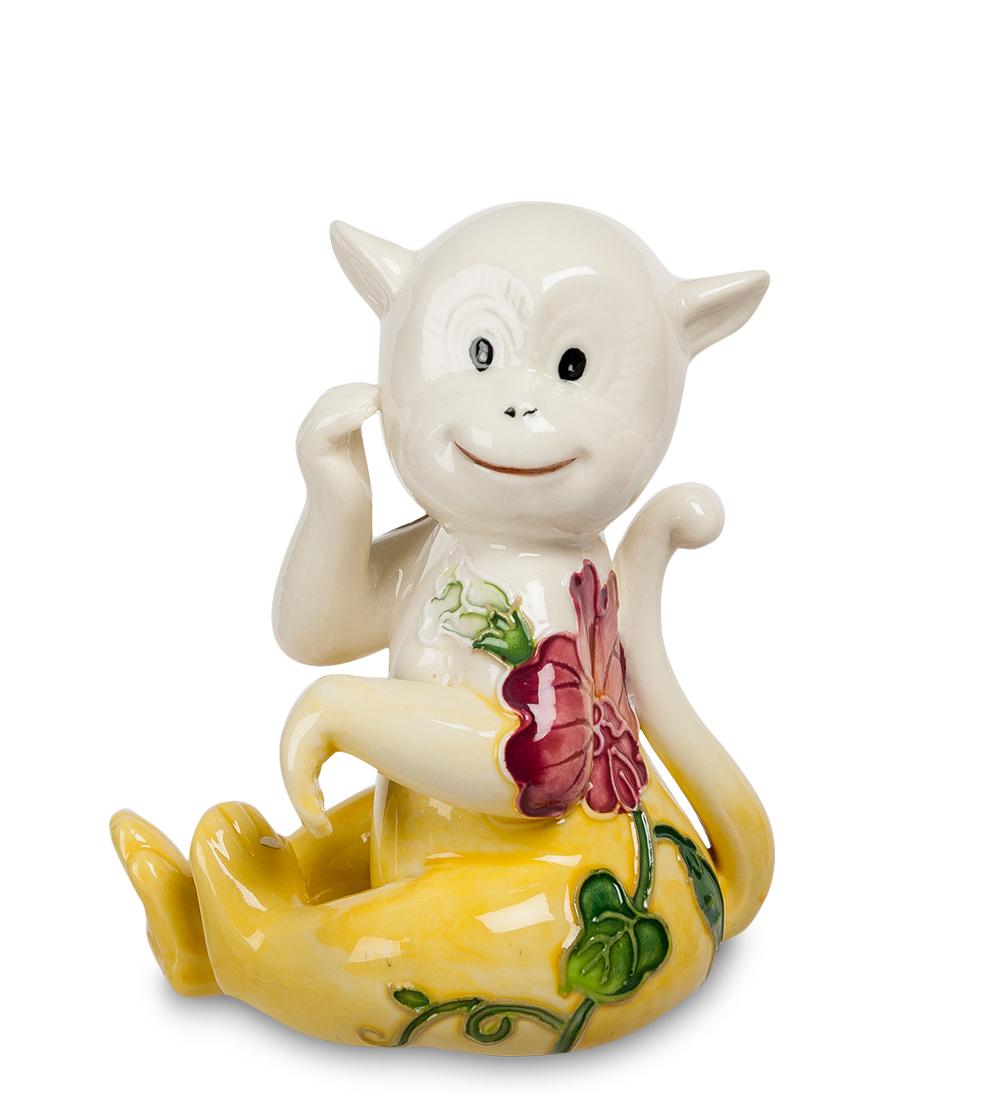 Фигурка декоративная Pavone Обезьяна, цвет: белый, желтыйMB860Декоративная фигурка Pavone Обезьяна станет оригинальным подарком для всех любителей стильных вещей. Сувенир выполнен из высококачественного фарфора в виде обезьянки, украшенной оригинальным узором. Изысканный сувенир станет прекрасным дополнением к интерьеру. Вы можете поставить фигурку в любом месте, где она будет удачно смотреться и радовать глаз.