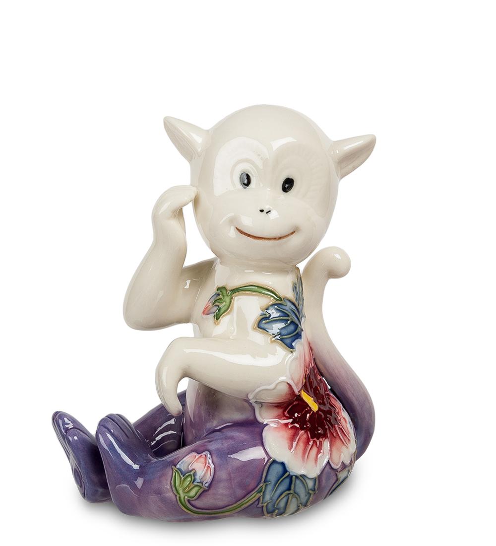 Фигурка декоративная Pavone Обезьяна, цвет: белый, фиолетово-розовыйSL250 503 09Декоративная фигурка Pavone Обезьяна станет оригинальным подарком для всех любителей стильных вещей. Сувенир выполнен из высококачественного фарфора в виде обезьянки, украшенной оригинальным узором. Изысканный сувенир станет прекрасным дополнением к интерьеру. Вы можете поставить фигурку в любом месте, где она будет удачно смотреться и радовать глаз.