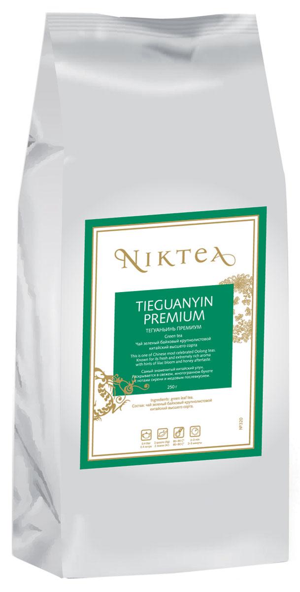 Niktea Tieguanyin Premium зеленый листовой чай, 250 гTALTHB-DP0016Niktea Tieguanyin Premium - самый знаменитый китайский улун. Раскрывается в свежем, многогранном букете с нотами сирени и медовым послевкусием.NikTea следует правилу качество чая - это отражение качества жизни и гарантирует: Тщательно подобранные рецептуры в коллекции топовых позиций-бестселлеров. Контролируемое производство и сертификацию по международным стандартам. Закупку сырья у надежных поставщиков в главных чаеводческих районах, а также в основных центрах тимэйкерской традиции - Германии и Голландии. Постоянство качества по строго утвержденным стандартам. NikTea - это два вида фасовки - линейки листового и пакетированного чая в удобной технологичной и информативной упаковке. Чай обладает многофункциональным вкусоароматическим профилем и подходит для любого типа кухни, при этом постоянно осуществляет оптимизацию базовой коллекции в соответствии с новыми тенденциями чайного рынка.Листовая коллекция NikTea представлена в герметичной фольгированной упаковке, которая эффективно предохраняет чай от воздействия света, влаги и посторонних запахов, обеспечивая длительное хранение. Каждая упаковка снабжена этикеткой с подробным описанием чая, его состава, а также способа заваривания.