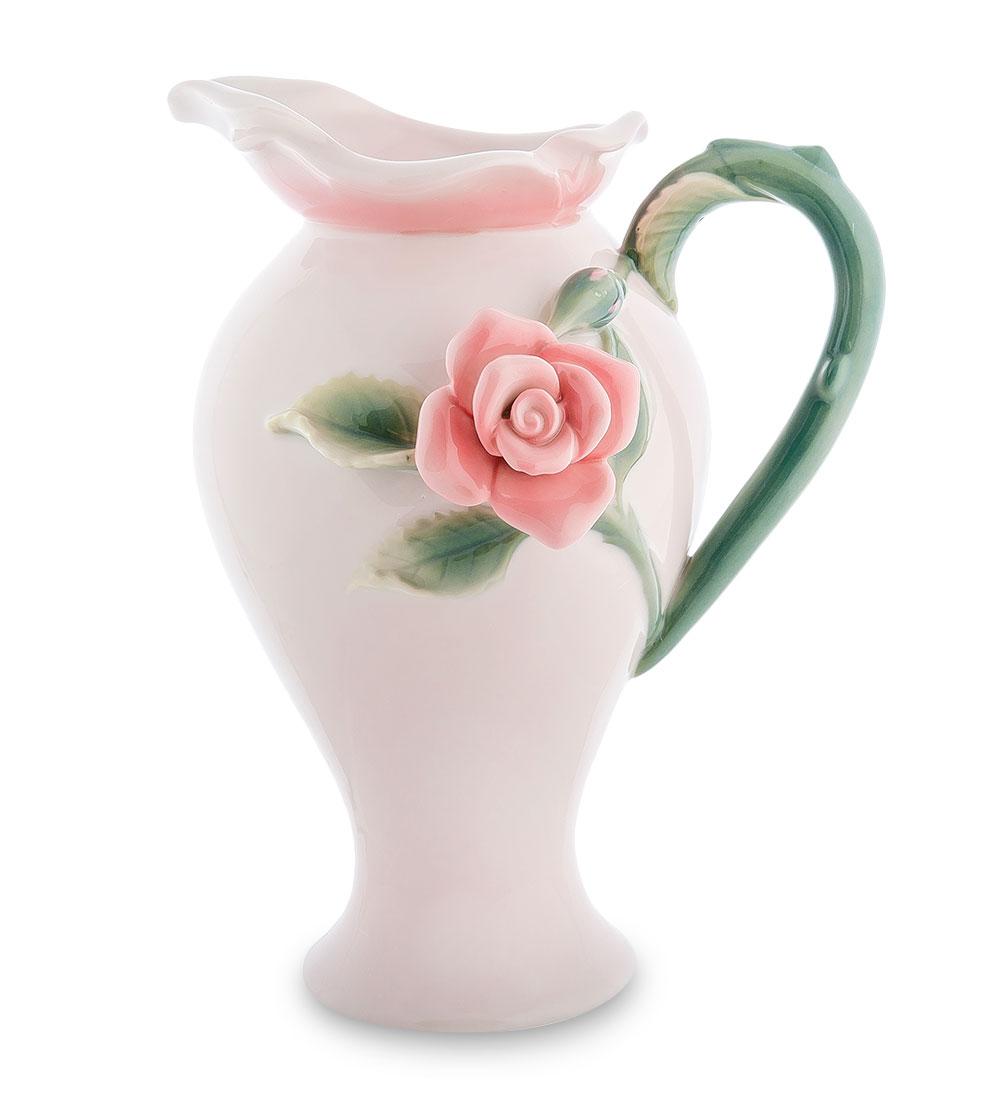 Кувшин Pavone Роза, 1 лVT-1520(SR)Кувшин Pavone Роза выполнен из фарфора и украшен изящным объемным бутоном розы. В нем будет удобнохранить и подавать на стол молоко, соки или воду.Такой кувшин украсит любой кухонный интерьер и станетхорошим подарком для ваших близких.Диаметр дна: 8 см см.Диаметр горлышка: 6 см. Высота: 22 см.