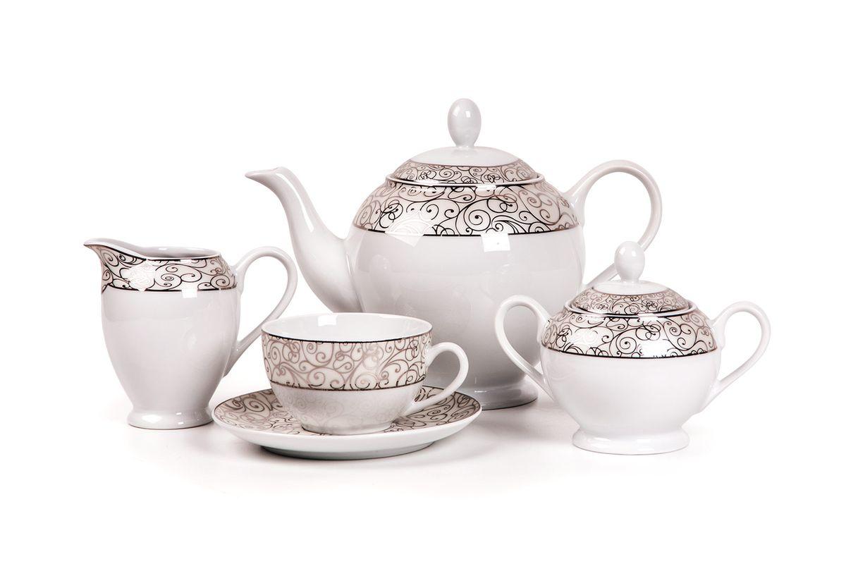 Isis 1672 сервиз чайный, 15пр, цвет: белый с платинойVT-1520(SR)Чайник 1,2л, сахарница 250мл, молочник 240мл, чайная пара 210 мл *6 штук . Фарфор фабрики Tunisie Porcelaine, производится в Тунисе из знаменитой своим качеством и белизной глины, добываемой во французской провинции Лимож.Преимущества этого фарфора заключаются в устойчивости к сколам и трещинам, что возможно благодаря двойному термическому обжигу. Европейский дизайн, декор и формы обеспечиваются за счет тесного сотрудничества фабрики с ведущими мировыми дизайн-бюро такими как: Nelly Reynal, Yves De la Rosiere, Sarah Anderson, Heracles. Материал: фарфор: цвет: белый с платинойСерия: ISIS