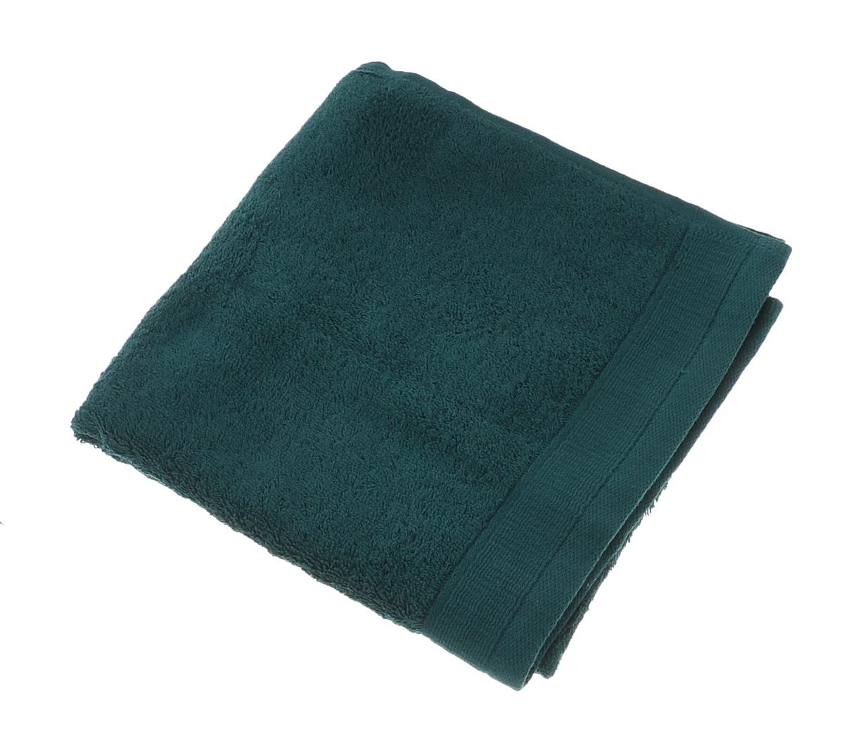 Полотенце махровое Guten Morgen, цвет: темно-зеленый, 50 см х 100 см68/5/4Махровое полотенце Guten Morgen, изготовленное из натурального хлопка, прекрасно впитывает влагу и быстро сохнет. Высокая плотность ткани делает полотенце мягкими, прочными и пушистыми. При соблюдении рекомендаций по уходу изделие сохраняет яркость цвета и не теряет форму даже после многократных стирок. Махровое полотенце Guten Morgen станет достойным выбором для вас и приятным подарком для ваших близких. Мягкость и высокое качество материала, из которого изготовлено полотенце, не оставит вас равнодушными.