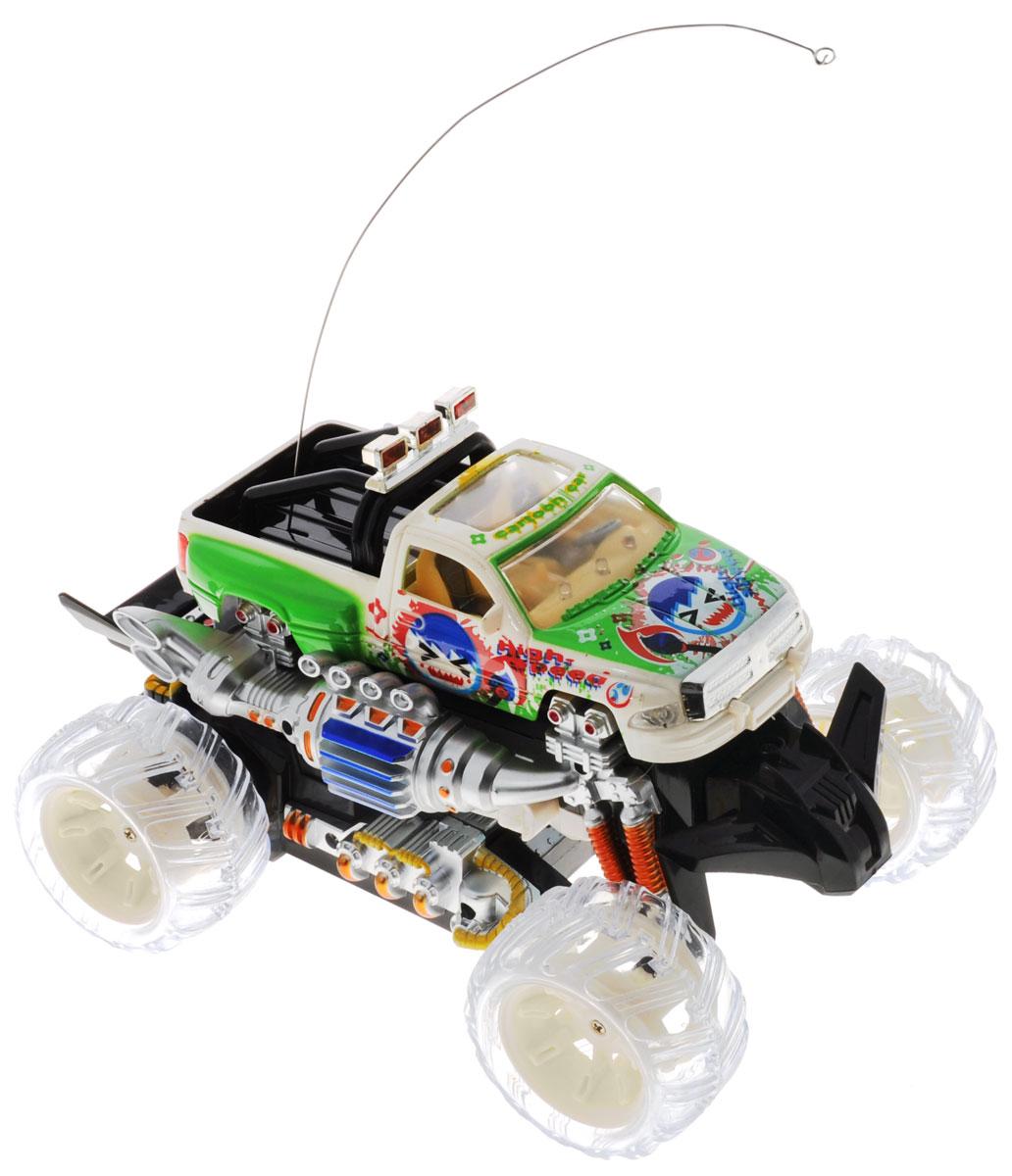 """Радиоуправляемая машинка-трансформер Zhorya """"Автоагент"""" обязательно привлечет внимание и взрослого, и ребенка, и несомненно понравится любому мальчишке. Игрушка выполнена в виде монстр-трака, который нажатием кнопки трансформируется в боевого робота. Детализированный корпус машинки изготовлен из металла, а внешние элементы из мягкого пластика. Модель имеет прорезиненные колесики, которые обеспечивают надежное сцепление с поверхностью, и дополнена лампочками со световыми эффектами. Колеса вращаются независимо друг от друга. Игрушка может вращаться на 360°, она двигается вперед, дает задний ход, поворачивает влево и вправо, останавливается. Игрушка также дополнена русскоязычными звуковыми эффектами. Пульт имеет эргономичные ручки, благодаря чему его удобно держать. Ваш ребенок часами будет играть с моделью, придумывая различные истории и устраивая соревнования. Порадуйте его таким замечательным подарком! Для работы пульта управления необходим аккумулятор 9V (входит..."""