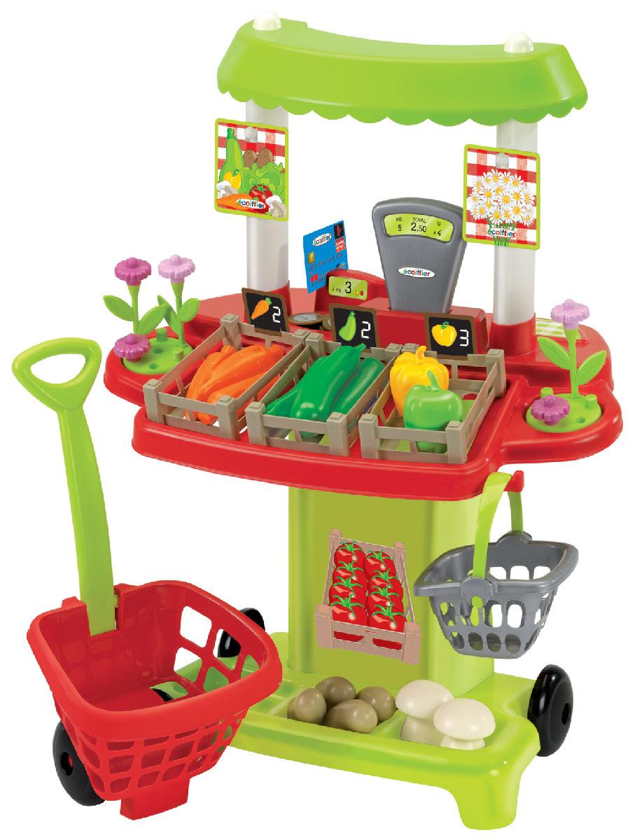 """Игровой набор Ecoiffier """"Овощной супермаркет"""" позволит малышу не только весело провести время, но и в простой игровой форме познакомиться с цифрами, счетом, а также выучить названия овощей. В комплект входит высокий пластиковый прилавок с кассой и контейнерами для овощей, тележка для покупок на колесиках, оснащенная удобной длинной ручкой, переносная корзинка для покупок, а также множество ярких муляжей овощей: морковь, кабачки, перцы, картофель и грибочки. Все элементы набора выполнены из прочного безопасного пластика ярких цветов и имеют увеличенные размеры, специально для маленьких пальчиков малыша. С помощью этого набора ваш ребенок сможет научиться правильно вести себя в магазине и делать покупки. Порадуйте его таким замечательным подарком!"""