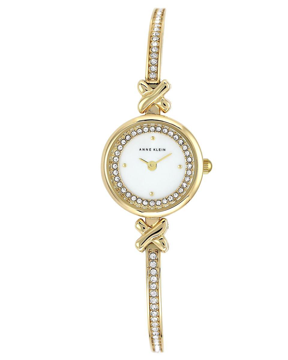 Часы наручные женские Anne Klein, цвет: белый, золотой. 1688MPGBBM8434-58AEЭлегантные женские часы Anne Klein выполнены из металлического сплава и минерального стекла. Циферблат изделия дополнен вставкой из перламутра, символикой бренда и стразами. Браслет часов оформлен стразами.Корпус часов оснащен кварцевым механизмом, имеет степень влагозащиты равную 3 atm, а также дополнен устойчивым к царапинам минеральным стеклом. Браслет оснащен складным замком, который позволит с легкостью снимать и надевать часы, а также регулировать длину изделия.Часы поставляются в фирменной упаковке.Часы Anne Klein подчеркнут изящность женской руки и отменное чувство стиля у их обладательницы.