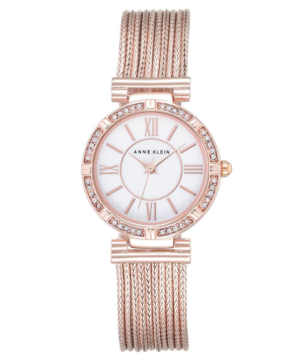 Часы наручные женские Anne Klein, цвет: белый, золотой. 2144MPRGBM8434-58AEЭлегантные женские часы Anne Klein выполнены из металлического сплава и минерального стекла. Циферблат изделия дополнен символикой бренда и вставкой из перламутра. Корпус оформлен стразами Svarowski.Корпус часов оснащен кварцевым механизмом, имеет степень влагозащиты равную 3 atm, а также дополнен устойчивым к царапинам минеральным стеклом. Браслет часов выполнен из десяти цепочек и оснащен складным замком, который позволит с легкостью снимать и надевать изделие, а также регулировать длину.Часы поставляются в фирменной упаковке.Часы Anne Klein подчеркнут изящность женской руки и отменное чувство стиля у их обладательницы.