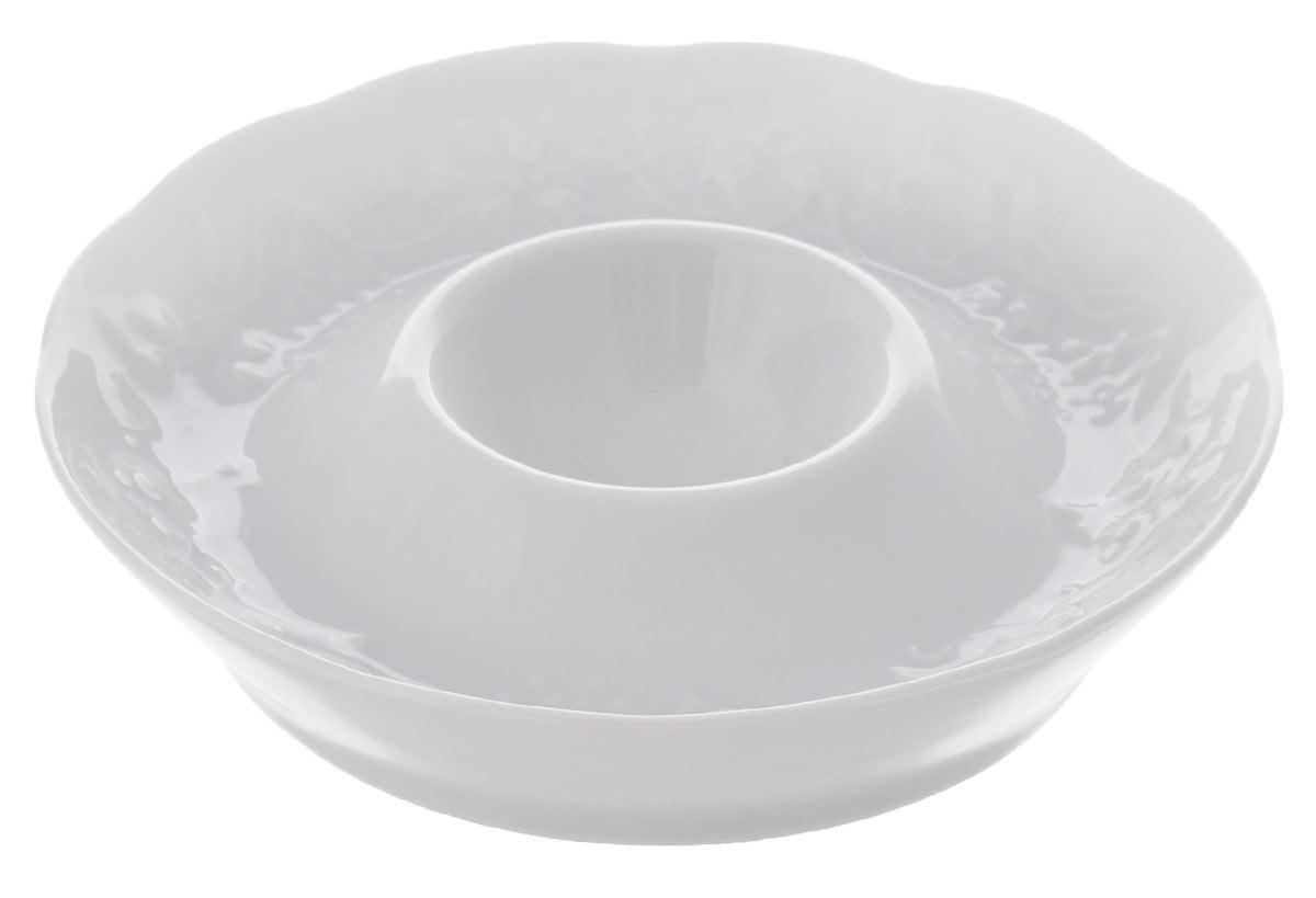 Подставка для яйца La Rose Des Sables, цвет: белый, диаметр 11 см115510Подставка для яйца La Rose Des Sables станет оригинальным украшением праздничного стола на Пасху. Изделие выполнено из высококачественного фарфора и оформлено выпуклыми на ощупь узорами.Изделие служит подставкой для яйца и может стать красивым пасхальным подарком дляваших друзей и близких.Диаметр подставки (по верхнему краю): 11 см.Высота подставки: 2,5 см.
