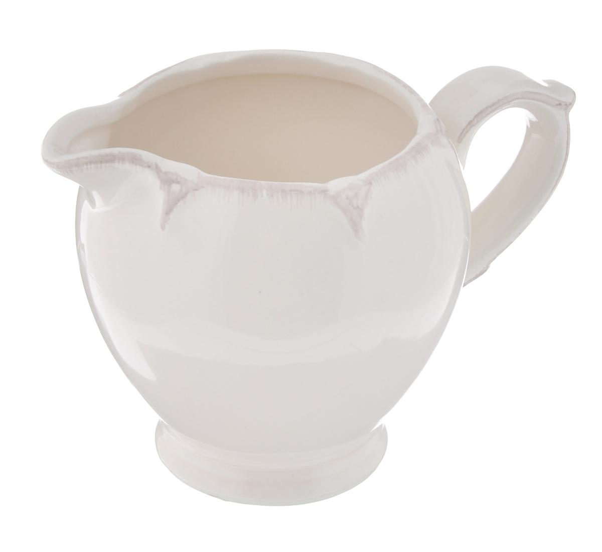 Молочник Лилло Ideal, 250 млVS-1204Молочник Лилло Ideal выполнен из высококачественной керамики керамики. Изделие станет незаменимым аксессуаром для тех, кто любит пить кофе или чай с добавлением молока.Дизайн молочника придется по вкусу и ценителям классики, и тем, кто предпочитает утонченность и изысканность. Также молочник послужит приятным и практичным подарком. Он упакован в красочную картонную коробку.Диаметр молочника по верхнему краю: 7 см.Диаметр дна: 5,2 см.Высота молочника: 8,5 см.Объем молочника: 250 мл.