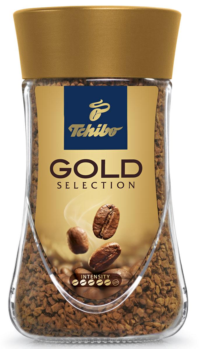 Tchibo Gold Selection кофе растворимый, 95 г0120710Порадуйте себя благородным вкусом и насыщенным ароматом кофе Tchibo Gold Selection. Зерна Tchibo Gold Selection тщательно обжариваются небольшими партиями до благородного золотисто-коричневого оттенка. Эта особая золотистая обжарка позволяет раскрыть необычайно богатый вкус и насыщенный аромат кофейных зерен.