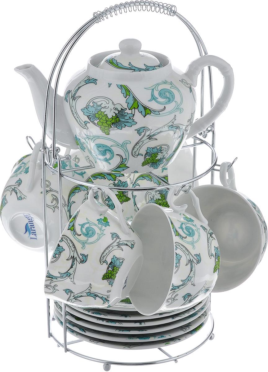 Чайный набор LarangE Рококо, цвет: белый, светло-зеленый, 14 предметовVT-1520(SR)Чайный набор LarangE Рококо состоит из шести чашек, шести блюдец и заварочного чайника,изготовленных из фарфора. Предметы набора оформленыизящным ярким рисунком и размещаются на металлической подставке.Чайный набор LarangE Рококо украсит ваш кухонный стол, а такжестанет замечательным подарком друзьям и близким.Объем чашки: 250 мл.Диаметр чашки по верхнему краю: 9 см.Высота чашки: 6 см.Диаметр блюдца: 14,5 см.Объем чайника: 600 мл.Диаметр чайника по верхнему краю: 7 см.Высота чайника (без учета крышки): 9 см.Размеры подставки (без учета ручки): 16 см х 20 см х 20 см.