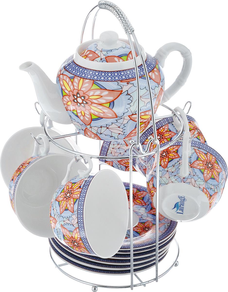 Чайный набор LarangE Витраж, цвет: голубой, персиковый, 14 предметовVT-1520(SR)Чайный набор LarangE Витраж состоит из шести чашек, шести блюдец и заварочного чайника,изготовленных из фарфора. Предметы набора оформленыизящным ярким рисунком и размещаются на металлической подставке.Чайный набор LarangE Витраж украсит ваш кухонный стол, а такжестанет замечательным подарком друзьям и близким.Объем чашки: 250 мл.Диаметр чашки по верхнему краю: 9 см.Высота чашки: 6 см.Диаметр блюдца: 14,5 см.Объем чайника: 600 мл.Диаметр чайника по верхнему краю: 7 см.Высота чайника (без учета крышки): 9 см.Размеры подставки (без учета ручки): 16 см х 20 см х 20 см.