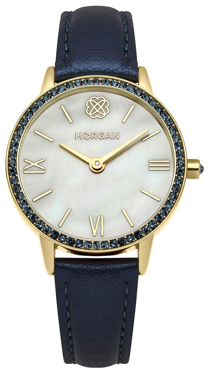 Часы наручные женские Morgan, цвет: золотистый, синий. M1242UGBM8434-58AEОригинальные женские часы Morgan выполнены из металлического сплава, натуральной кожи и минерального стекла. Корпус изделия дополнен символикой бренда и чешскими кристаллами. Циферблат оформлен вставкой из перламутра.Корпус часов оснащен кварцевым механизмом, имеет степень влагозащиты равную 3 atm, а также дополнен устойчивым к царапинам минеральным стеклом. Ремешок часов оснащен классической пряжкой, которая позволит с легкостью снимать и надевать изделие.Часы поставляются в фирменной упаковке.Часы Morgan подчеркнут изящность женской руки и отменное чувство стиля у их обладательницы.