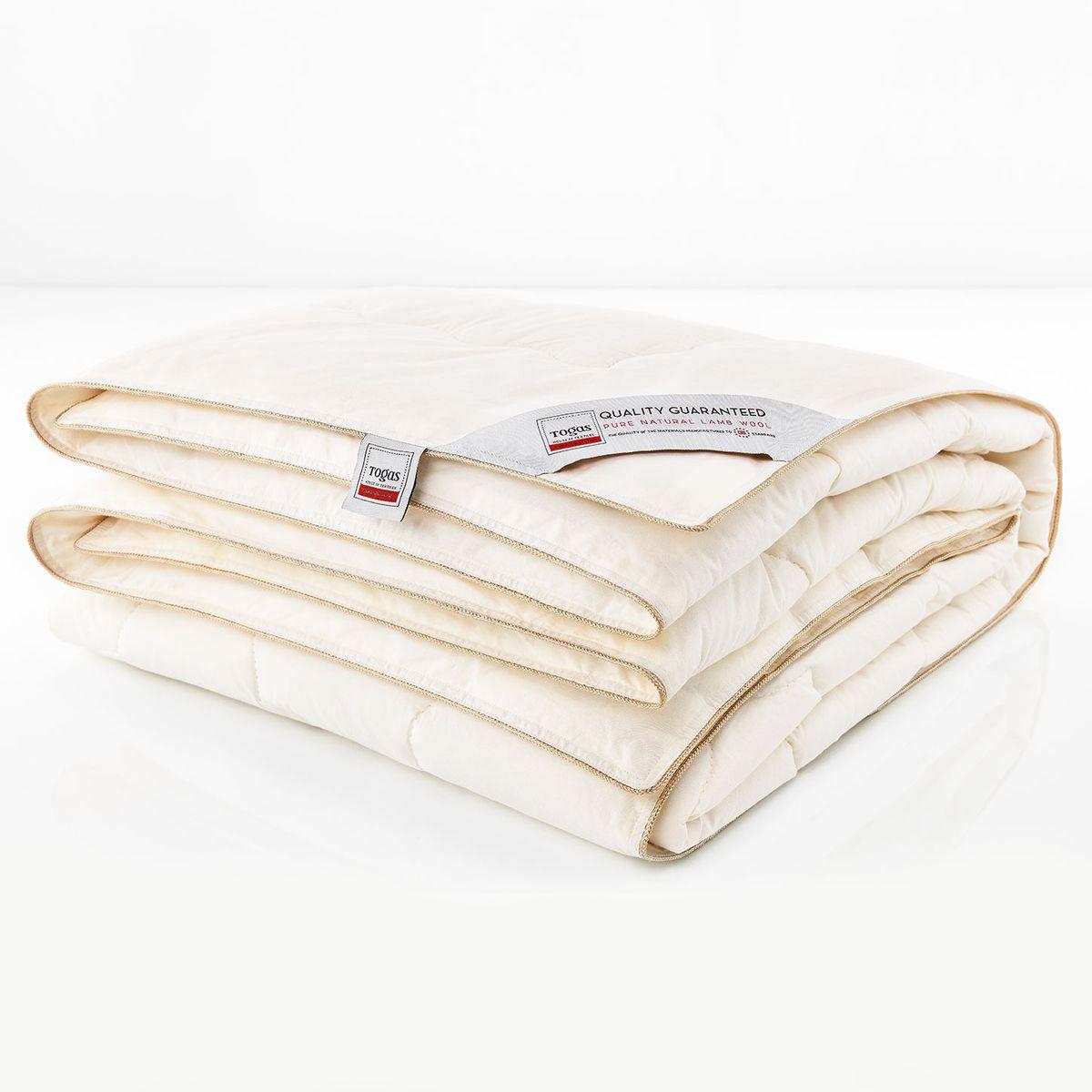 """Одеяло Togas Прима, наполнитель: овечья шерсть, 200 х 210 см531-105Овечья шерсть используется для изготовления подушек и одеял с незапамятных времен. Трудно переоценить их драгоценные свойства, рожденные самой природой. Сильный ветер и перепады температур на горных пастбищах, где испокон веков пасутся овцы, способствовали образованию роскошной легкой шубки, которая согревает в самый суровый холод - и отлично вентилирует в жару. Людям удалось создать материалы, аналогичные по своим теплорегулирующим свойствам, - но повторить целебные свойства шерсти не смог еще ни один ученый. Овечья шерсть содержит природное вещество - ланолин. Поэтому одеяла из натуральной шерсти рекомендуют людям, страдающим радикулитом, остеохондрозом и повышенным кровяным давлением. Шерсть способна создавать сухое тепло, которое оказывает благотворное воздействие на суставы. Такие одеяла по-настоящему """"дышат"""": между шерстяными волокнами постоянно циркулирует воздух, который помогает выводить лишнее тепло и влагу, создавая идеальный микроклимат во время сна. Нежное ощущение тепла и комфорта оказывает оздоравливающий, бодрящий эффект, который Вы чувствуете каждое утро. Овечьи одеяла очень износостойки, неприхотливы и просты в уходе, - они прослужат вам долгие годы, не потеряв своей формы и удивительных свойств."""