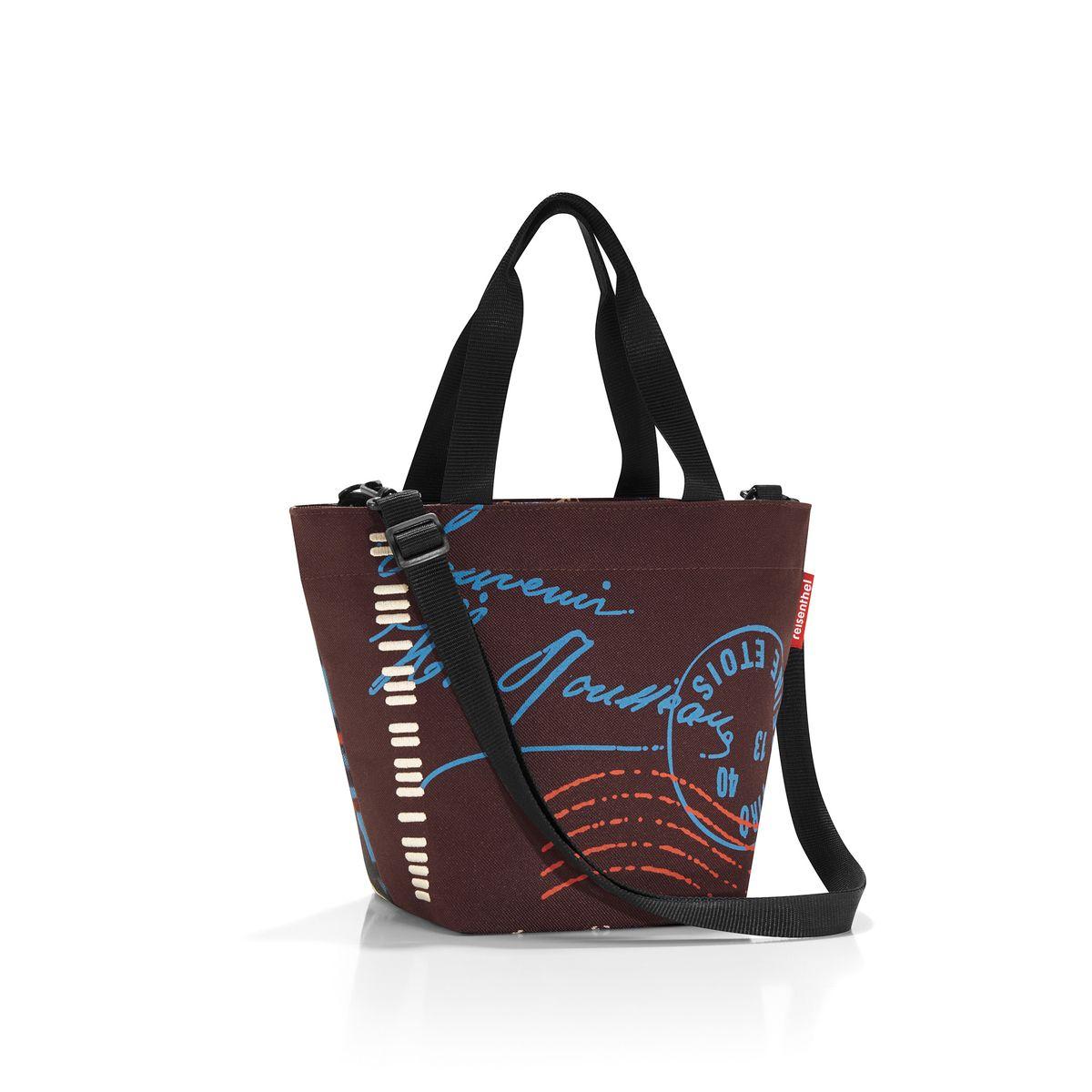 Сумка женская Reisenthel, цвет: коричневый, красный, голубой. ZR703723008Женская сумка Reisenthel изготовлена из полиэстера с оригинальным принтом. Сумка имеет одно отделение, которое закрывается на застежку-молнию. Внутри имеется нашивной карман на застежке-молнии. Изделие оснащено двумя текстильными ручками. В комплект входит съемный плечевой ремень. Такая сумка станет незаменимой в повседневной жизни.