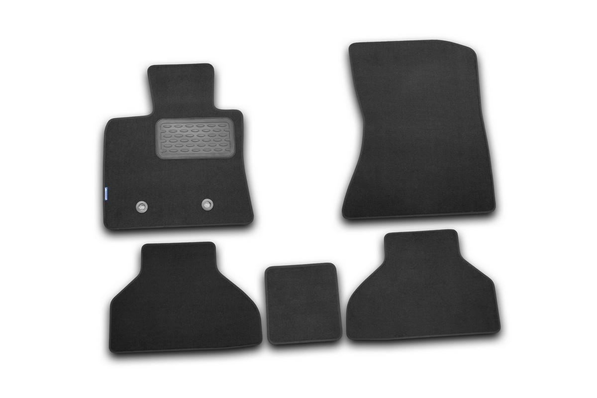 Набор автомобильных ковриков Novline-Autofamily для BMW X5 2007-, внедорожник, в салон, 5 штNLC.51.14.B10Набор автомобильных ковриков Novline-Autofamily, изготовленный из текстиля, состоит из 5 ковриков, которые учитывают все особенности каждой модели автомобиля и полностью повторяют контуры пола. Текстильные автомобильные коврики для салона произведены из высококачественного материала, который держит форму, прочный и не пачкает обувь. Коврики в салон не только улучшат внешний вид салона вашего автомобиля, но и надежно уберегут его от пыли, грязи и сырости, а значит, защитят кузов от коррозии. Текстильные коврики для автомобиля мягкие и приятные, а их основа из вспененного полиуретана не пропускает влагу. Ковры для автомобилей надежно крепятся на полу и не скользят, что очень важно во время движения. Чистятся коврики очень просто: как при помощи автомобильного пылесоса, так и различными моющими средствами. Набор подходит для BMW X5 внедорожник с 2007 года выпуска.