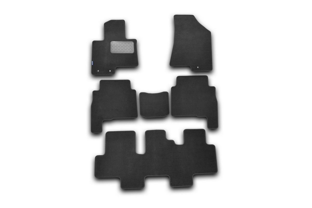Набор автомобильных ковриков Novline-Autofamily для Kia Sorento 2009-2012, внедорожник, в салон, 6 штВетерок 2ГФНабор автомобильных ковриков Novline-Autofamily, изготовленный из текстиля, состоит из 6 ковриков, которые учитывают все особенности каждой модели автомобиля и полностью повторяют контуры пола. Текстильные автомобильные коврики для салона произведены из высококачественного материала, который держит форму, прочный и не пачкает обувь. Коврики в салон не только улучшат внешний вид салона вашего автомобиля, но и надежно уберегут его от пыли, грязи и сырости, а значит, защитят кузов от коррозии. Текстильные коврики для автомобиля мягкие и приятные, а их основа из вспененного полиуретана не пропускает влагу. Ковры для автомобилей надежно крепятся на полу и не скользят, что очень важно во время движения. Чистятся коврики очень просто: как при помощи автомобильного пылесоса, так и различными моющими средствами. Набор подходит для Kia Sorento внедорожник 2009-2012 годов выпуска.