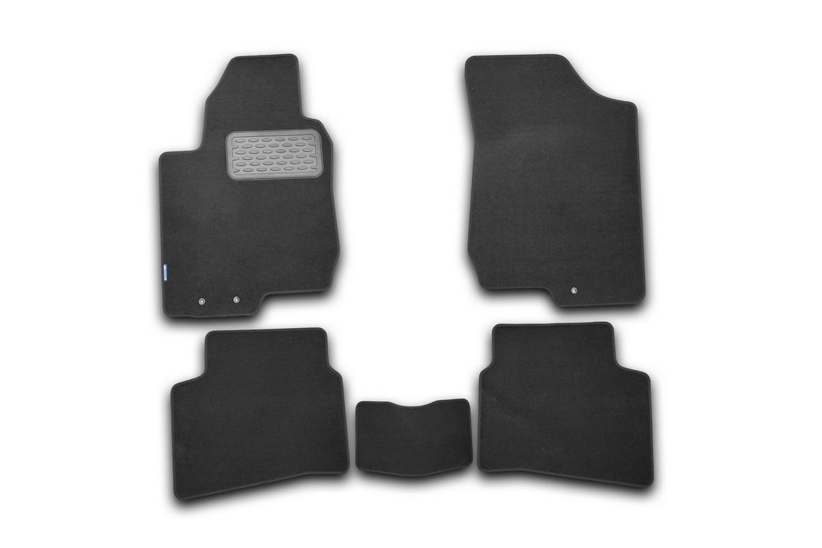 Набор автомобильных ковриков Novline-Autofamily для Kia Pro Ceed 2011-, хэтчбек, в салон, 5 шт. NLT.25.38.11.110khВетерок 2ГФНабор автомобильных ковриков Novline-Autofamily, изготовленный из текстиля, состоит из 5 ковриков, которые учитывают все особенности каждой модели автомобиля и полностью повторяют контуры пола. Текстильные автомобильные коврики для салона произведены из высококачественного материала, который держит форму, прочный и не пачкает обувь. Коврики в салон не только улучшат внешний вид салона вашего автомобиля, но и надежно уберегут его от пыли, грязи и сырости, а значит, защитят кузов от коррозии. Текстильные коврики для автомобиля мягкие и приятные, а их основа из вспененного полиуретана не пропускает влагу. Ковры для автомобилей надежно крепятся на полу и не скользят, что очень важно во время движения. Чистятся коврики очень просто: как при помощи автомобильного пылесоса, так и различными моющими средствами. Набор подходит для Kia Pro Ceed хэтчбек с 2011 года выпуска.
