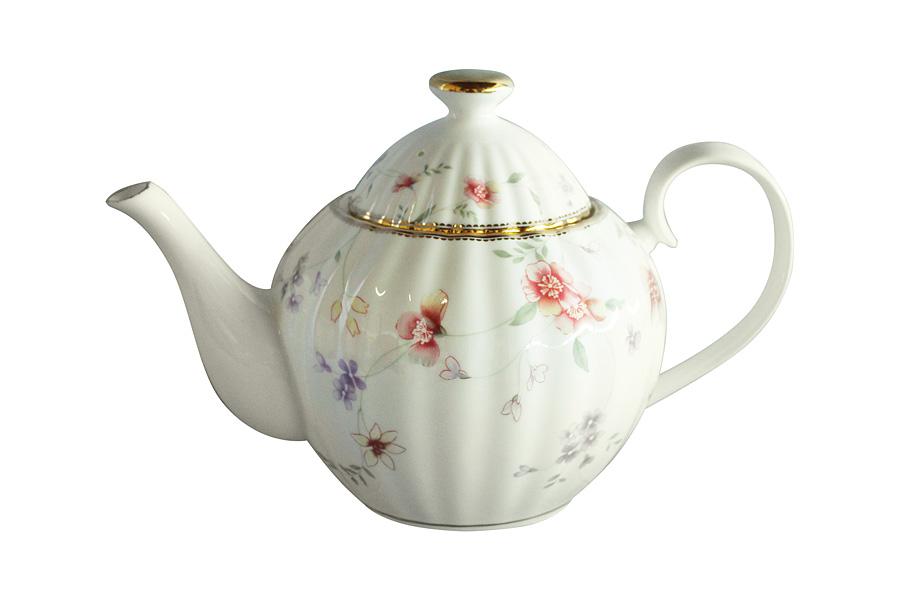 Чайник заварочный Colombo Флер, 1,2 л115510Заварочный чайник Colombo Флер сочетает в себе изысканный дизайн с максимальной функциональностью. Красочность оформления придется по вкусу и ценителям классики, и тем, кто предпочитает современный стиль. Чайник выполнен из костяного фарфора. Нежный цветочный рисунок придает модели особый шарм, который понравится каждому.Объем чайника: 1,2 л.