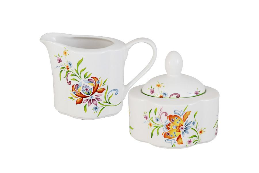 Набор Imari Аквитания: сахарница, молочник8420-46 RS\SBНабор Imari Аквитания, состоящий из сахарницы с крышкой и молочника, выполнен из высококачественной глазурованной керамики. Изделия, декорированные красочным изображением цветов, имеют изысканный внешний вид. Такой набор прекрасно подойдет для сервировки стола и станет незаменимым атрибутом чаепития. Объем молочника: 300мл. Объем сахарницы: 250 мл.