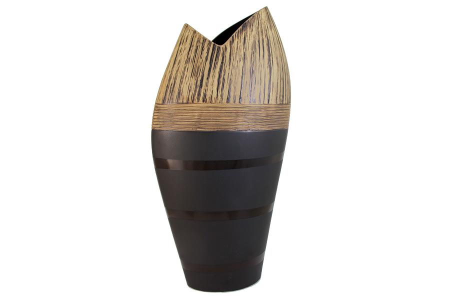 Ваза SDJ Бангкок, высота 46 смPH3728Изящная ваза SDJ Бангкок, изготовленная из высококачественной керамики, выполнена в этническом стиле. Она красиво переливается и излучает приятный блеск. Изделие имеет оригинальную форму, что делает ее изящным украшением интерьера. Ваза SDJ Бангкок дополнит интерьер офиса или дома и станет желанным и стильным подарком. Высота вазы: 46 см.