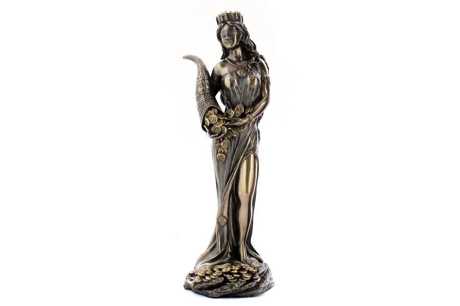 Статуэтка Veronese Фортуна, высота 18,5 см37914Декоративная статуэтка Veronese Фортуна изготовлена из полистоуна бронзового цвета. Вы можете поставить статуэтку в любом месте, где она будет удачно смотреться и радовать глаз. Такая фигурка прекрасно дополнит интерьер офиса или дома. Veronese - это торговая марка, представляющая широкий ассортимент художественных изделий из полистоуна, выполненных по эскизам итальянских дизайнеров и художников. Полистоун представляет собой специальную массу с полимерными связующими материалами, которые абсолютно не токсичны.