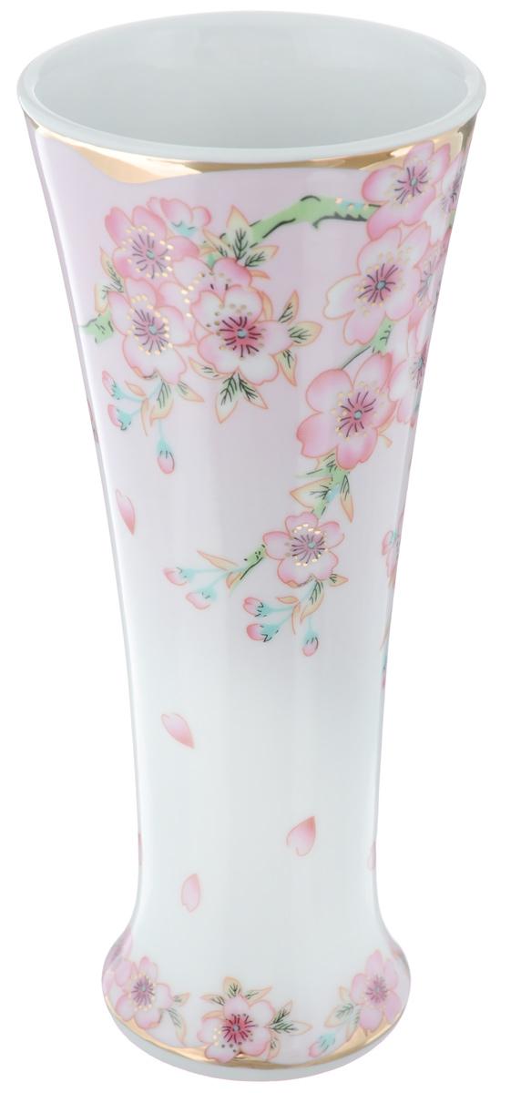 Ваза Elan Gallery Сакура, высота 18 смFS-91909Декоративная ваза Elan Gallery Сакура украсит ваш интерьер и будет прекрасным подарком для ваших близких! Изделие выполнено из высококачественного фарфора и украшено ярким рисунком. Оригинальный дизайн наполнит ваш дом праздничным настроением. Такая ваза станет желанным подарком для ваших близких!Диаметр вазы по верхнему краю: 7,7 см.Диаметр дна: 5,5 см.Высота вазы: 18 см.