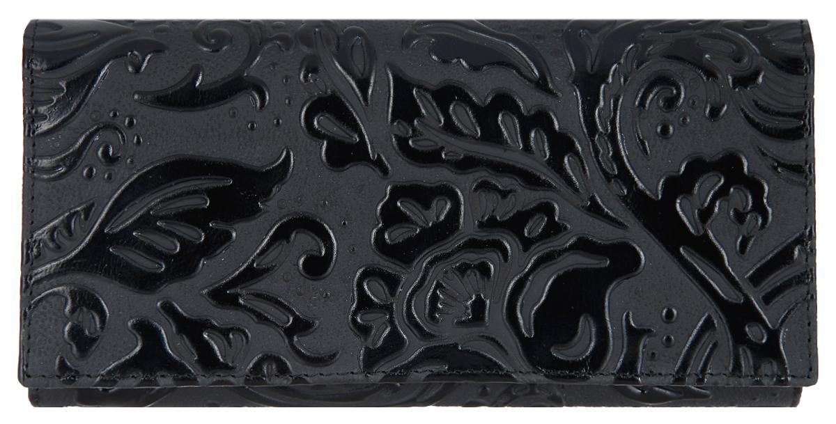 Портмоне женское Dimanche Elite. Арабеска, цвет: черный. 991/1W16-11135_914Стильное женское портмоне Dimanche Elite. Арабеска выполнено из натуральной кожи с рельефным рисунком. Внутри находятся два отделения для купюр, одно из которых разделено пополам карманом-средником на застежке-молнии, шесть кармашков для визиток и пластиковых карт, один из которых с прозрачным окошечком и потайной карман. Портмоне закрывается клапаном на кнопку. Снаружи, на передней стенке под клапаном расположен карман для чеков и два кармашка для визиток и пластиковых карт. На задней стенке предусмотрен карман для мелких бумаг.Изделие упаковано в фирменную коробку.Такое портмоне станет замечательным подарком человеку, ценящему качественные и практичные вещи.