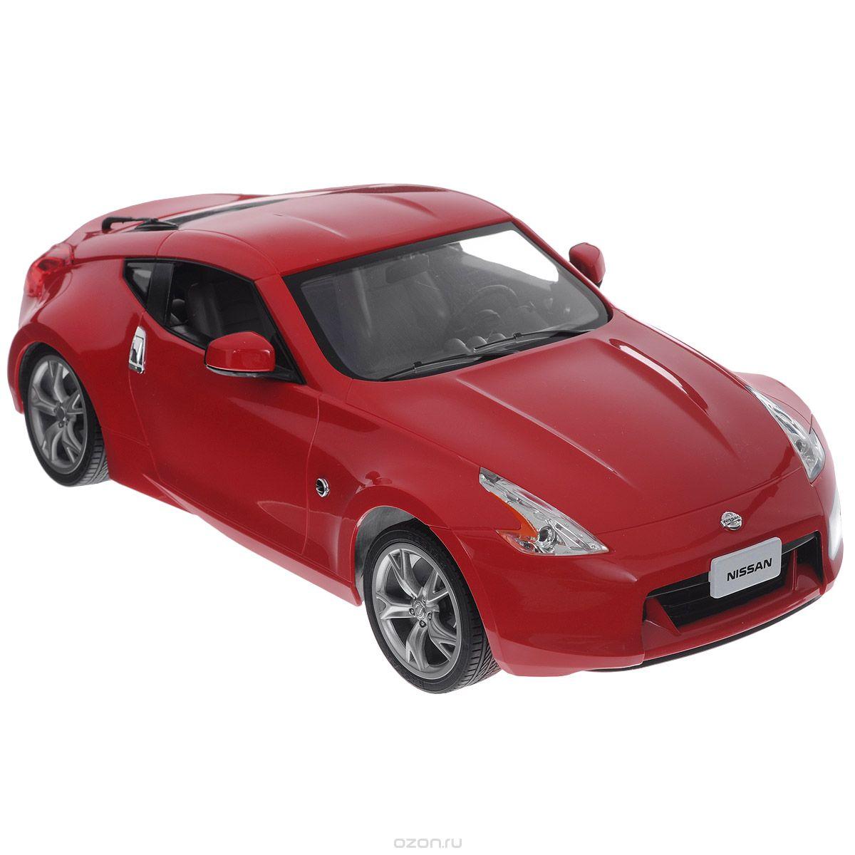 """Радиоуправляемая модель """"Nissan 370Z"""" привлечет внимание не только ребенка, но и взрослого и станет отличным подарком любителю всего оригинального и необычного. Машинка является точной уменьшенной копией автомобиля. Машинка изготовлена из прочных материалов, шины выполнены из мягкой резины. Фары машины светятся. Машинка может перемещаться вперед, дает задний ход, поворачивает влево и вправо, останавливается. Ваш ребенок часами будет играть с моделью, придумывая различные истории и устраивая соревнования. Порадуйте его таким замечательным подарком! Машина работает от 5 батареек """"AA"""", пульт дистанционного управления работает от батареи """"9V"""" (не входят в комплект)."""