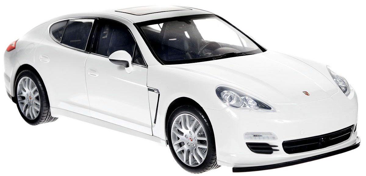 """Радиоуправляемая модель """"Porsche Panamera S"""" со световыми эффектами, являющаяся точной копией настоящего автомобиля - отличный подарок не только ребенку, но и взрослому. Автомобиль изготовлен из современных ударопрочных материалов и обладает высокой стабильностью движения, что позволяет полностью контролировать его процесс, управляя без суеты и страха сломать игрушку. Основные направления движения автомобиля: вперед-назад-влево-вправо. Движение вперед и назад сопровождается сигнальными световыми эффектами фар. Двери автомобиля открываются, внутри - подробная имитация салона. Двери также можно открыть кнопкой на пульте управления. В комплект входят автомобиль, пульт управления и инструкция на английском языке. Автомобиль работает от 6 батарей типа АА, пульт управления - от 4 батарей типа АА (не входят в комплект)."""