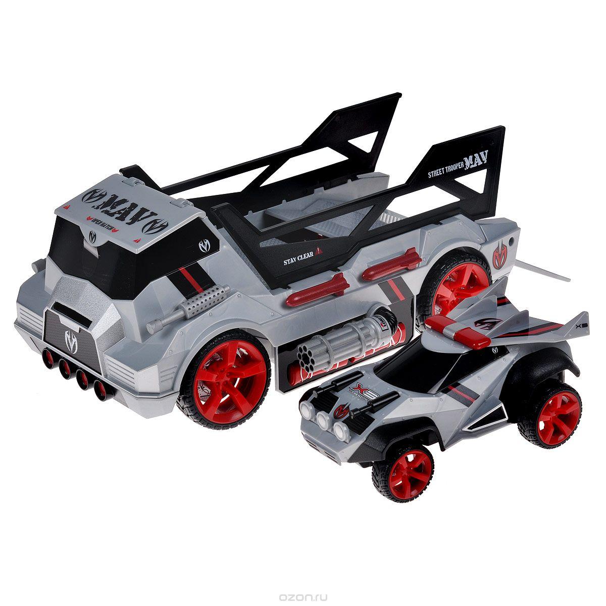 """Радиоуправляемая модель Maisto """"Menace Hauler+Scout X3"""" непременно понравится любому мальчику. Набор выполнен из безопасного пластика и включает хаулер и машинку. С помощью пульта управления можно управлять либо хаулером, либо машинкой. Хаулер способен стрелять дисками. Машинка представляет собой разведывательный автомобиль, который оснащен рулевым управлением и механизмом переднего и заднего хода. Трап поднимается автоматически, когда автомобиль снова оказывается на борту. В комплект входит хаулер, машина, пульт управления, 12 дисков и инструкция по эксплуатации на русском языке. Порадуйте своего ребенка таким замечательным подарком! Пульт управления работает от аккумулятора c напряжением 9V (входит в комплект). Хаулер работает от 6 батарей напряжением 1,5V типа AA (входят в комплект). Машинка работает от 3 батарей напряжением 1,5V типа AA (входят в комплект)."""
