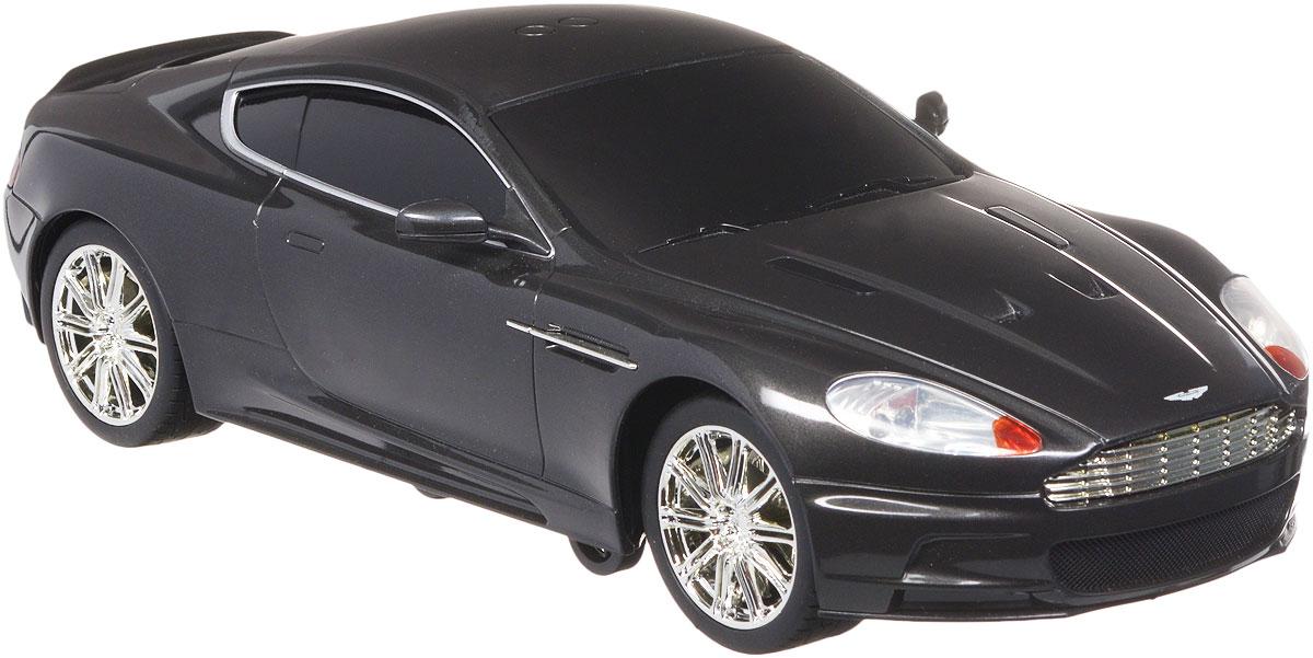 """Радиоуправляемая модель Toystate """"Aston Martin DBS"""" - это миниатюрная копия автомобиля Джеймса Бонда, которая управляется дистанционно. Машинка даст малышу почувствовать себя в роли популярного шпиона британской спецслужбы MI-6. Модель изготовлена из прочного пластика, оснащена световыми и звуковыми эффектами при движении и отлично подойдет для игры как дома, так и на улице в песочнице, при этом готова подарить вашему малышу отличное времяпрепровождение и массу удовольствия. Движения: вперед, назад, вправо, влево, подъем на задние колеса, наклон в левую сторону. Радиоуправляемая модель Toystate """"Aston Martin DBS"""" это отличный вариант для пополнения коллекции хороших и качественных игрушек. Для работы игрушки необходимы 6 батареек типа АА (товар комплектуется демонстрационными). Для работы пульта управления необходимы 3 батарейки типа ААА (не входят в комплект)."""
