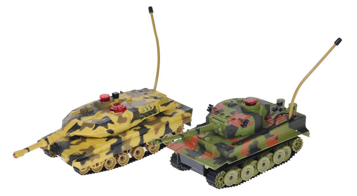 """Набор радиоуправляемых моделей 1TOY """"Танковый бой: Взвод"""" - отличный подарок не только ребенку, но и взрослому, с помощью которого можно устроить настоящий бой в домашних условиях. Танки на гусеничном ходу изготовлены из прочного пластика и снабжены пулеметом и пушкой. При помощи пульта управления каждый танк может двигаться вперед, назад, поворачивать влево и вправо, разворачиваться. Башня поворачивается на 300°, ствол поднимается и опускается. Танки снабжены инфракрасным датчиком, системой инфракрасного наведения и счетчиком жизней. Вы можете устроить танковое сражение: цельтесь пулеметами и пушками в инфракрасный датчик другого танка. После попадания на боевой машине гаснет один индикатор жизни. Бой заканчивается, когда на одном из танков гаснут все индикаторы жизни. Индикаторы попаданий на корпусе помогут вам не сбиться со счета, а реалистичные звуки движения и выстрелов танков сделают бой еще более захватывающим. Танки обладают дополнительными функциями:..."""