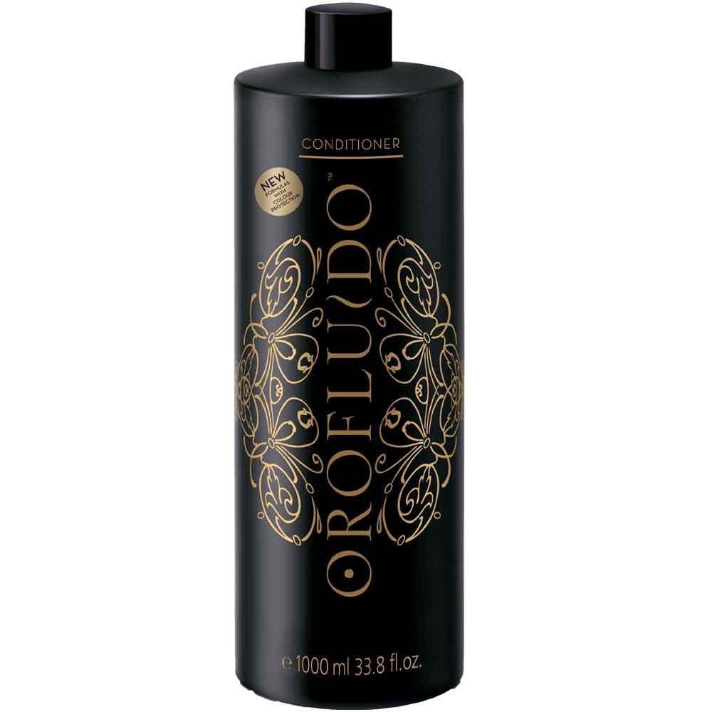 Orofluido Кондиционер для волос 1000 мл.FS-00897Чтобы ваши волосы стали мягкими, шелковистыми, используйте кондиционер Orofluido. Это средство подходит для регулярного ежедневного применения, для всех типов волос. В состав кондиционера входит комплекс натуральных масел, нежно ухаживающих за волосами. Даже если ваши волосы сильно пересушены, масло арганы обязательно вернет им блеск, сделает сильными, устранит зуд, а также снимет раздражение кожи головы. Льняное масло обладает уникальным свойством придавать волосам сияние и блеск, делать их завораживающе привлекательными. Кстати, этим свойством масла пользовались с давних пор египтяне. Льняное масло насыщает волосы витамином Е, делает их послушными. Такой компонент, как масло ситника, издавна славится своей способностью повышать эластичность волос, смягчать пряди и придавать им объем. Кроме того, вы непременно оцените восхитительный аромат бальзама!