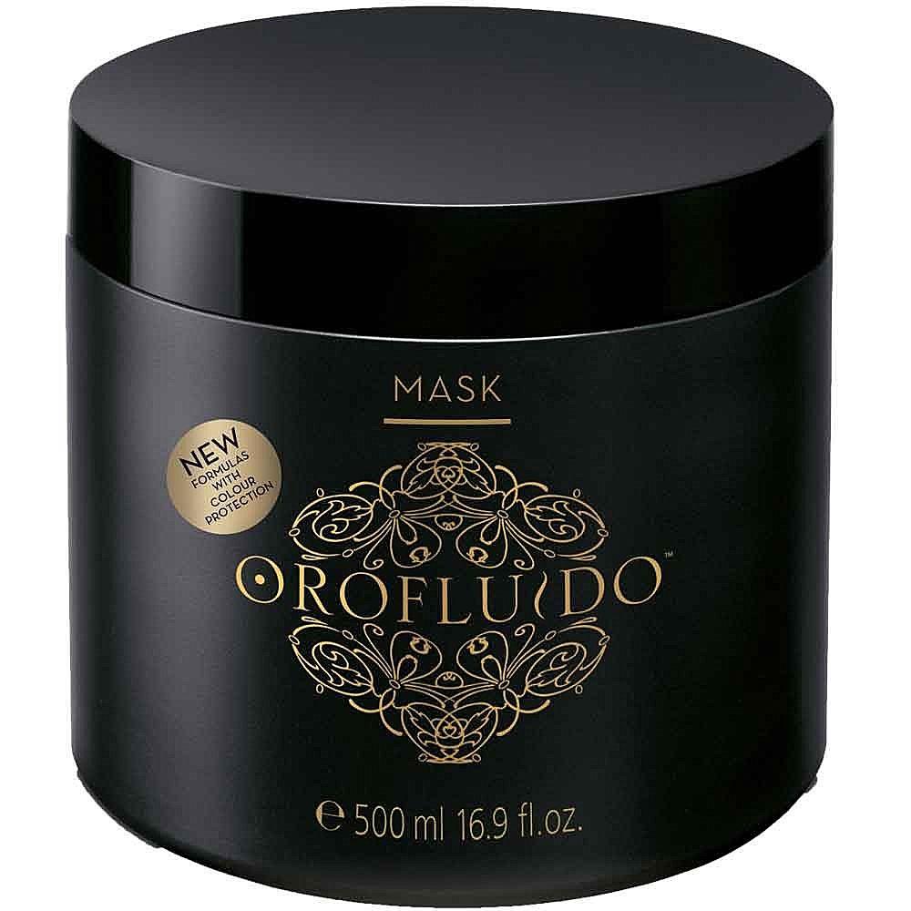 Orofluido Маска для волос 500 мл.7219947000Маска Orofluido обеспечит увлажнение вашим локонам, восстановит поврежденные волосы, вдохнет в них новую жизнь и сделает здоровыми и шелковистыми. В состав маски входят натуральные масла. Масло арганы оказывает целебное воздействие на окрашенные, поврежденные и сухие волосы, снимает зуд и раздражение кожи головы, защищает волосы от горячего воздуха и солнца. Масло ситника придает прядям объем, смягчает волосы, делает их эластичными. Льняное масло обладает особым эффектом: оно моментально придает волосам блеск, насыщая их витамином Е, запечатывает кутикулу, делая волосы гладкими. В состав средства также входят катионные компоненты, благодаря которым волосы не электризуются и буквально сияют здоровьем.