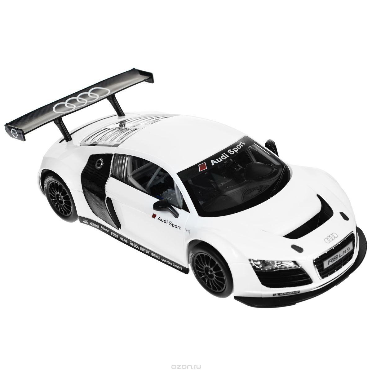 """Радиоуправляемая модель """"Audi R8 LMS"""" со световыми эффектами, являющаяся точной копией настоящего автомобиля, - отличный подарок не только ребенку, но и взрослому. Автомобиль с литым корпусом изготовлен из современных прочных материалов и обладает высокой стабильностью движения, что позволяет полностью контролировать его процесс, управляя без суеты и страха сломать игрушку. Основные направления движения автомобиля: вперед-назад-влево-вправо. Движение вперед и назад сопровождается сигнальными световыми эффектами фар. В комплект входят автомобиль, пульт управления и инструкция на русском языке. Автомобиль работает от 5 батарей типа АА, пульт управления - от 1 батареи 9V 6F22 (не входят в комплект)."""