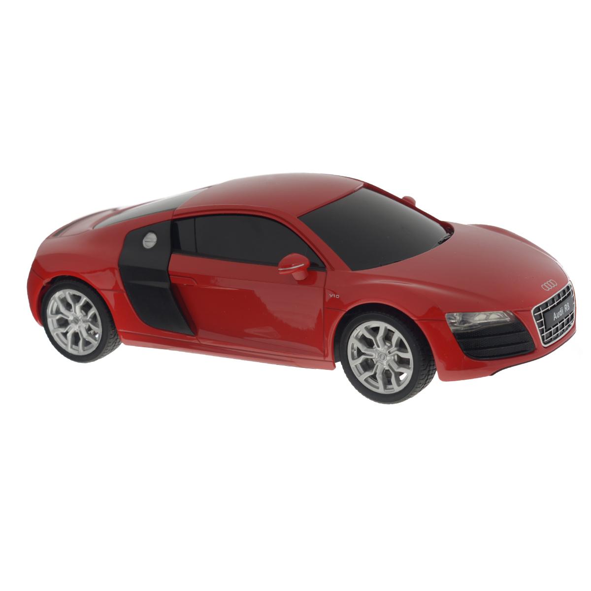 """Радиоуправляемая модель Welly """"Audi R8 V10"""" обязательно привлечет внимание взрослого и ребенка и понравится любому, кто увлекается автомобилями. Маневренная и реалистичная уменьшенная копия """"Audi R8 V10"""" выполнена в точной детализации с настоящим автомобилем в масштабе 1/24. Управление машинкой происходит с помощью пульта. Машинка двигается вперед и назад, поворачивает направо и налево. Радиус действия пульта - 8 метров. Колеса игрушки прорезинены и обеспечивают плавный ход, машинка не портит напольное покрытие. Радиоуправляемые игрушки способствуют развитию координации движений, моторики и ловкости. Ваш ребенок часами будет играть с моделью, придумывая различные истории и устраивая соревнования. Порадуйте его таким замечательным подарком! Питание: для работы машинки - 3 батарейки напряжением 1,5V типа АА; для работы пульта - 2 батарейки напряжением 1,5V типа АА (не входят в комплект)."""