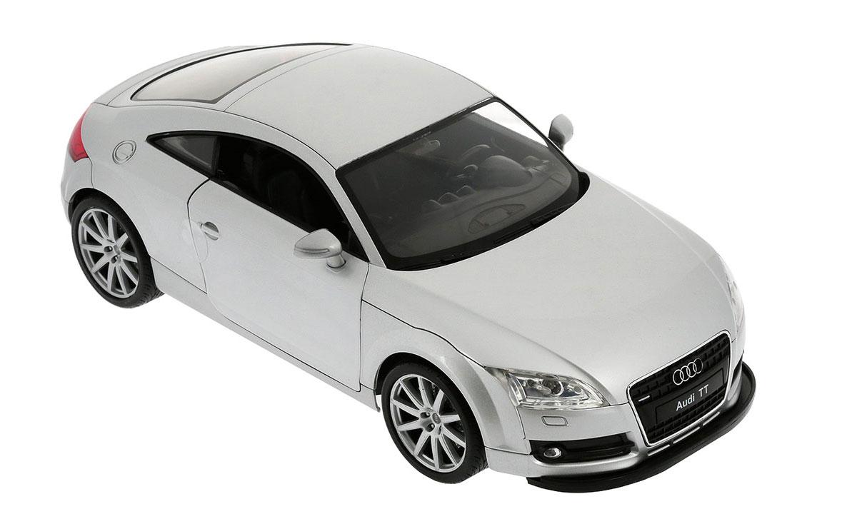 """Радиоуправляемая модель Welly """"Audi TT Coupe"""" обязательно привлечет внимание взрослого и ребенка и понравится любому, кто увлекается автомобилями. Маневренная и реалистичная уменьшенная копия """"Audi TT Coupe"""" выполнена в точной детализации с настоящим автомобилем в масштабе 1/12. Управление машинкой происходит с помощью пульта. Машинка двигается вперед и назад, поворачивает направо и налево. При движении загораются передние и задние фары. При помощи пульта у машинки открываются двери. Радиус действия пульта - 30 метров. Колеса игрушки прорезинены и обеспечивают плавный ход, машинка не портит напольное покрытие. Радиоуправляемые игрушки способствуют развитию координации движений, моторики и ловкости. Ваш ребенок часами будет играть с моделью, придумывая различные истории и устраивая соревнования. Порадуйте его таким замечательным подарком! Для работы машинки необходимо докупить 6 батареек напряжением 1,5V типа АА. Для работы пульта требуется 4 батарейки..."""