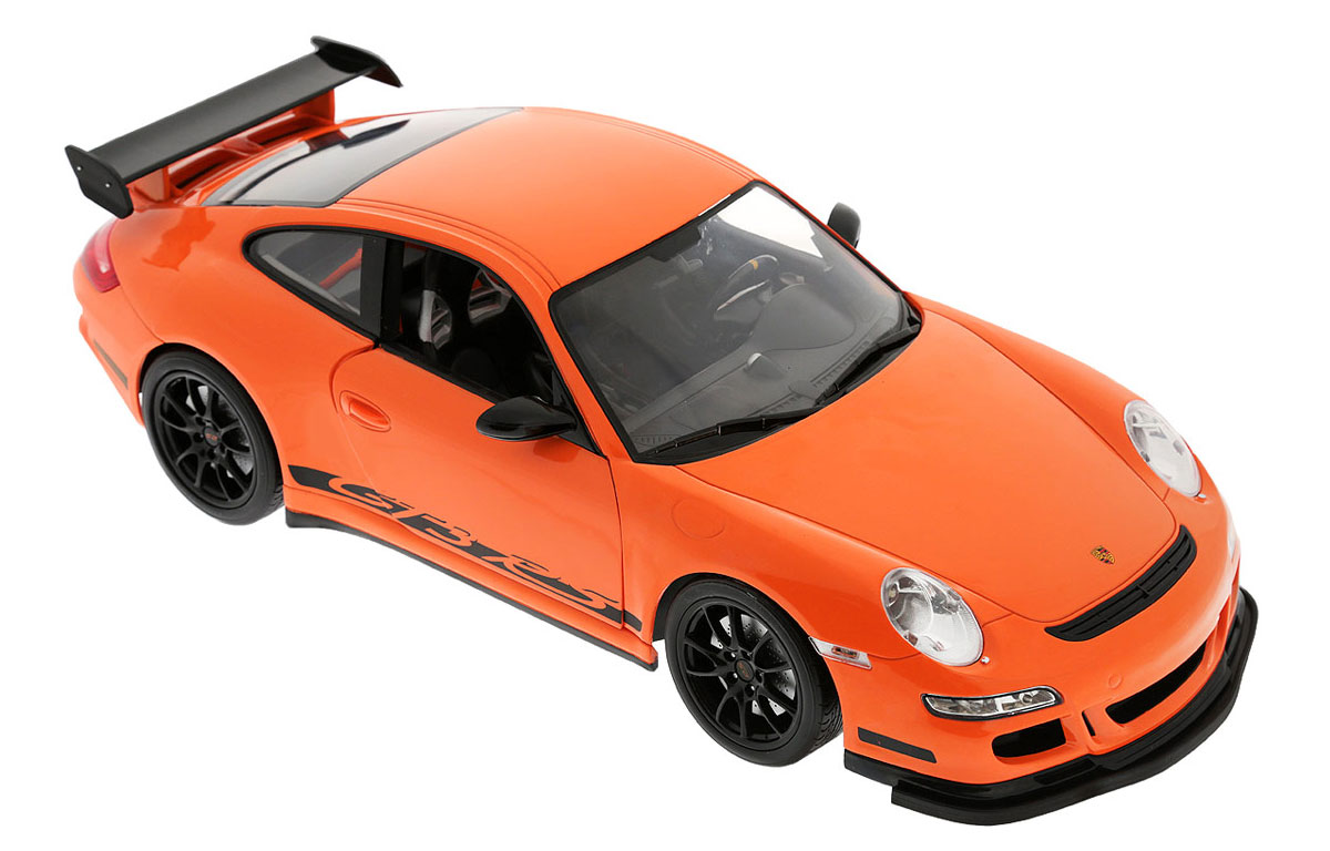"""Радиоуправляемая модель Welly """"Porsche 911 GT3 RS"""" обязательно привлечет внимание взрослого и ребенка и понравится любому, кто увлекается автомобилями. Маневренная и реалистичная уменьшенная копия Porsche 911 GT3 RS выполнена в точной детализации с настоящим автомобилем в масштабе 1/12. Управление машинкой происходит с помощью пульта. Машинка двигается вперед и назад, поворачивает направо и налево. При движении загораются передние и задние фары. При помощи пульта у машинки открываются двери. Радиус действия пульта - 30 метров. Колеса игрушки прорезинены и обеспечивают плавный ход, машинка не портит напольное покрытие. Радиоуправляемые игрушки способствуют развитию координации движений, моторики и ловкости. Ваш ребенок часами будет играть с моделью, придумывая различные истории и устраивая соревнования. Порадуйте его таким замечательным подарком! Для работы машинки необходимо докупить 6 батареек напряжением 1,5V типа АА. Для работы пульта требуется 4..."""